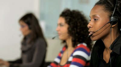 stock-footage-multiethnic-group-of-female-customer-service-representatives-talking-on-the-phone-and-looking-at