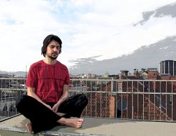 Meditating in an urban environment Photo Credit : Wikimedia Commons