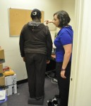 Clinical Volunteer Alice Bonner, RN provides BMI assessment